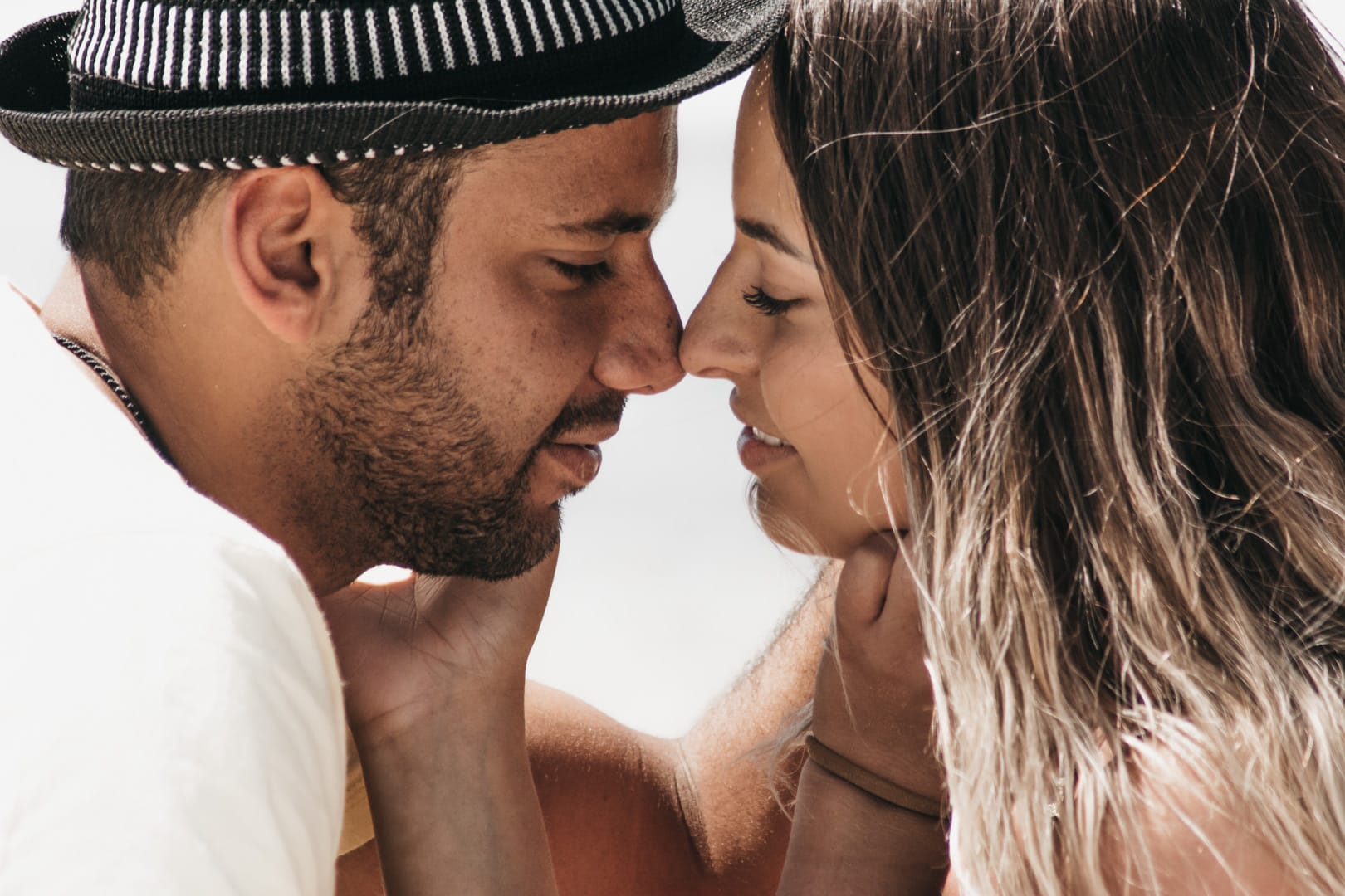 honeymoon photographer algarve. close up of the couple smiling with eyes closed